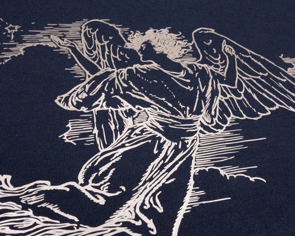 A detailed angel pressed on a black shirt in Champagne ThermoFlex® Plus