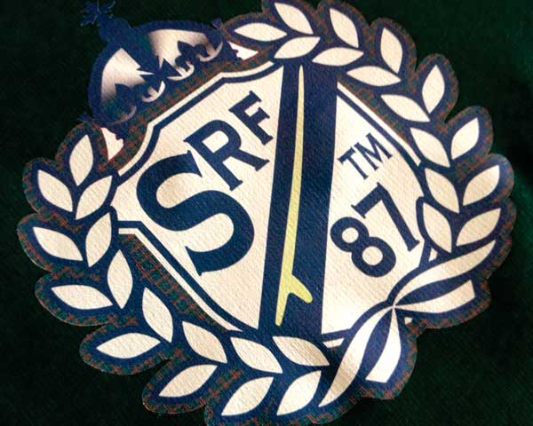 An image printed onto EcoPrint and pressed- it shows the letters SRF 87 and is sharped like a crest.