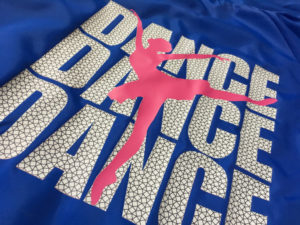 "A ballerina design that has the words ""Dance Dance Dance"""