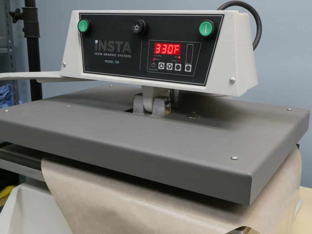 The heat press up to proper temperature for ThermoFlex Plus which is 330 degrees