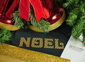 "Image depicting the downloadable cut file that says ""Noel"" outlined in GlitterFlex Ultra"