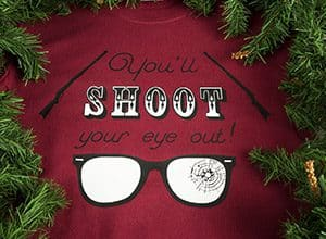 """Image depicting the downloadable cut file that says """"You'll Shoot Your Eye Out"""" with rifle decorations and broken glasses"""