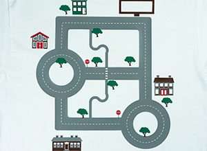 Image depicting the downloadable cut file that has a street and houses to make a car shirt