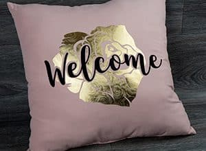 """Image depicting the downloadable cut file that says """"Welcome"""" and a rose in the background"""