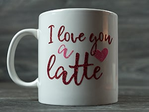 """The finished mug reading """"I love you a latte"""" made in Red and Rainbow Red Pressure Sensitive GlitterFlex Ultra"""