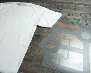 A plaid white shirt laid out with the cut ThermoFlex Plus read to be pressed