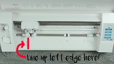 Showing you where to put the edge of the material on the Silhouette Cameo 3