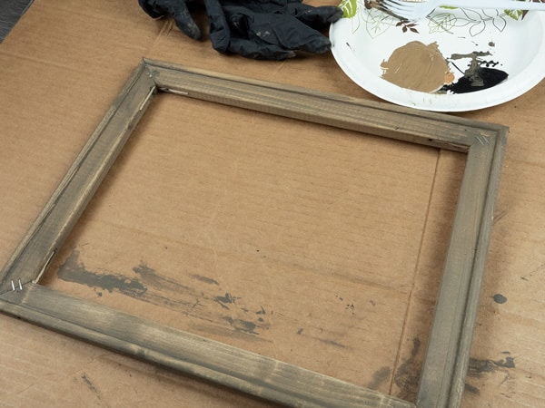 Showing the frame after the first layer of stain