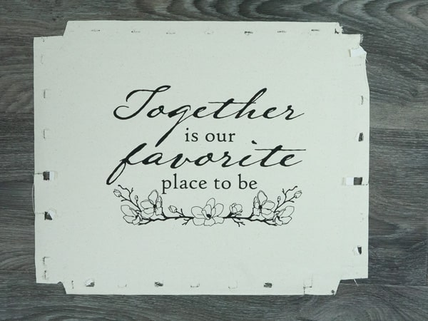 """The """"Together is our favorite place to be"""" after being pressed onto canvas"""