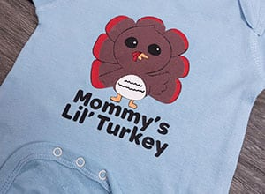"""Image depicting the downloadable cut file that says """"Mommy's Lil' Turkey"""" with a cute turkey"""