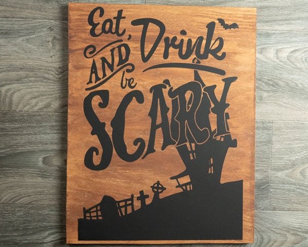 """A bigger image of the finished wood project- it reads """"Eat Drink and Be Scary"""" made using ThermoFlex Turbo"""