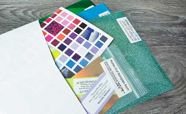 A picture showing what a sample pack looks like- it comes with a brochure, cut samples, and three sample sheets