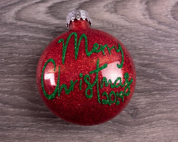 A finished ornament with red glitter on the inside and Pressure Sensitive GlitterFlex® Ultra