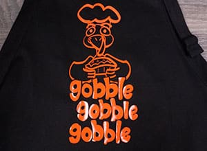 "The available cut file showing a turkey with the words ""gobble gobble gobble"""