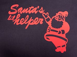 "Shows the available cut file which has Santa pointing to the words ""Santa's Lil Helper"""