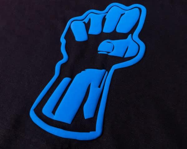 A fist pressed in Neon Blue FashionFlex® Puff
