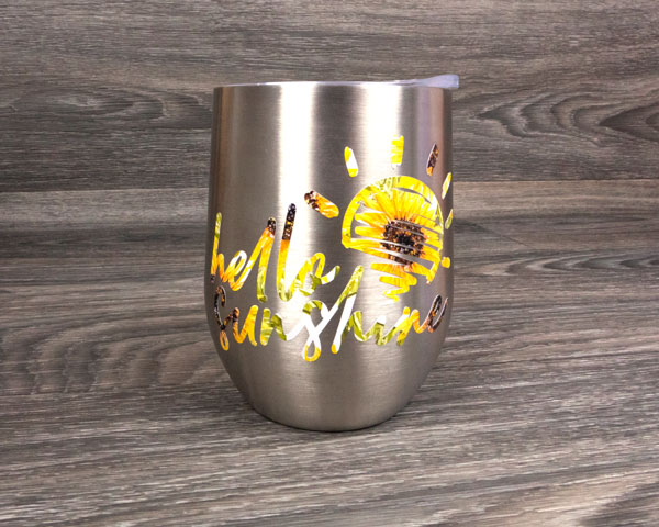 A metallic wine glass with Sunflower SpecialtyPSV Fashion Patterns decorating it